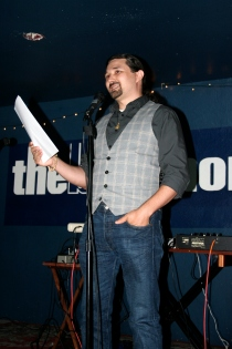 Reading fiction at The Blue Monk for the Ampersand West Coast Invasion! event, in Portland, OR, September 2012.