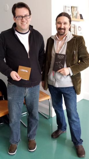 Portland author Mark Russell, with me (I'm holding Mark's book, God Is Disappointed in You)