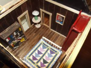 The model bedroom with the miniature bookshelf....