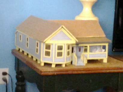 This is the repainted dollhouse.