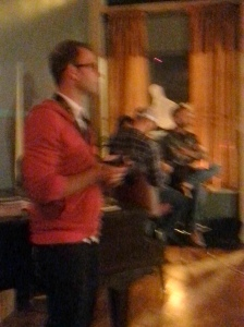 My phone takes terrible photos in low light, but that's Brooks in the red cardigan.