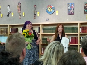 Edee Lemonier, who designed Ellen's website, receiving flowers from Ellen.