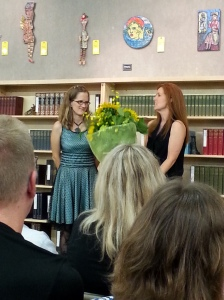 The brilliant Laura Stanfill, the publisher behind Forest Avenue Press, receiving flowers from Ellen.