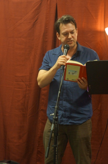 Mark Russell throwing down a sick beat and rapping his way through some apocryphal texts (photo by LS)