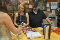 Monica Drake signs a book for my friends Jacquline and John